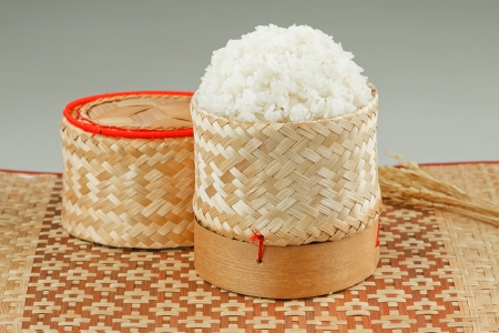 Thai asian sticky rice in a bamboo wooden old style box