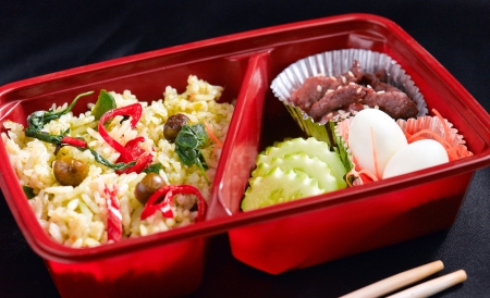 Green curry Thai food style in the lunchbox photo