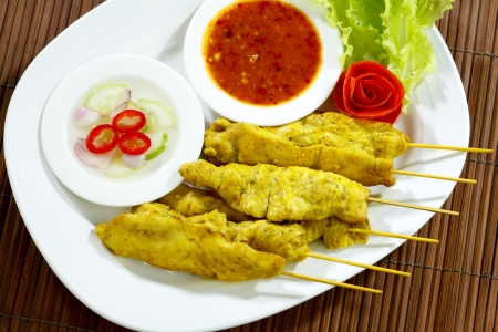 Grilled pork stick a special Thai favorite snack food on dish Stock Photo - 18019945