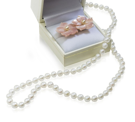 string of pearls: Beautiful pearls necklace with box the luxury gifts isolated