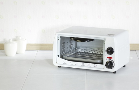 Empty home appliance roaster oven in the kitchen  photo