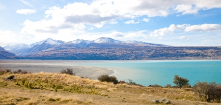 Beautiful panorama scenery Tasman turquoise lake in autumn Mt Cook national park southern Alps mountain valleys New Zealand  photo