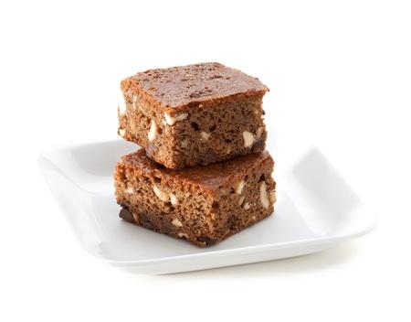 custard slices: Sweet eatable brownie cake good for coffee or tea break isolated on dish