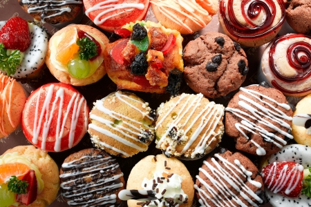 custard flavor: Fancy color of muffins display and variety of topping Stock Photo