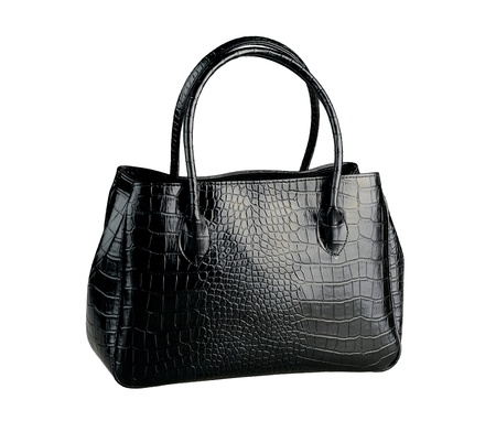 Beautiful black leather handbag made from crocodile leather isolated  photo