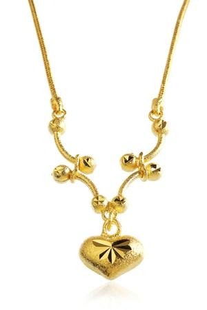 Золотой кулон ожерелье с формы сердца Фото со стока