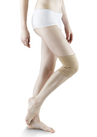 orthopaedic: woman ware knee pad for relief support and protection isolated