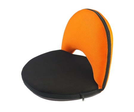 hassock: Beautiful portable or movable seat in orange color