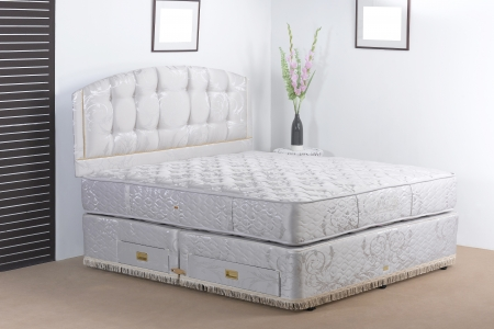 Luxury bedding mattress in a set up bedroom atmosphere  photo