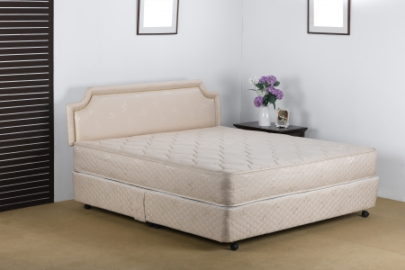Nice and luxury bedding mattress in a set up bedroom atmosphere photo