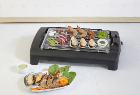 Seafood barbecue grills on the stove in the kitchen photo