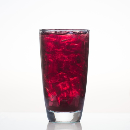 grape juice: Sweet grape juice with ice in glass isolated on white background Stock Photo