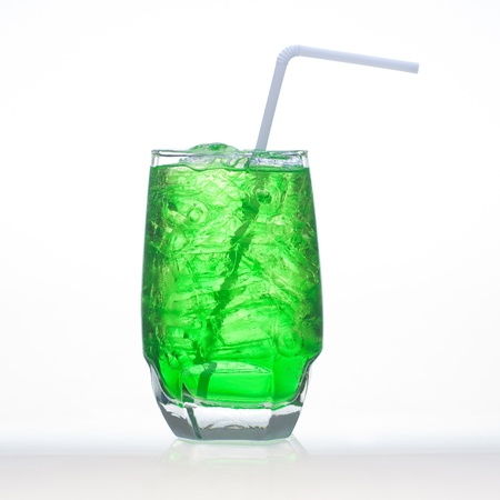carbonated: Green fruit flavor soft drinks whit soda water isolated on white