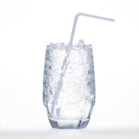 drinks whit sparklng soda and ice in glass isolated on white