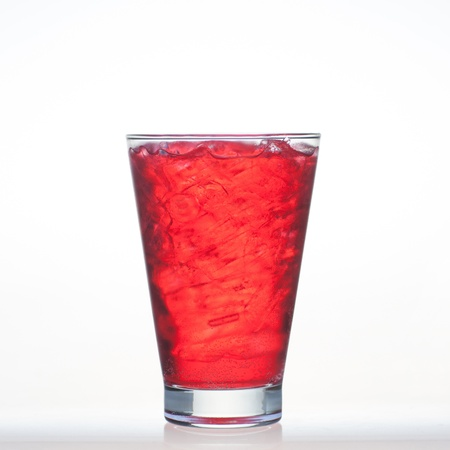 Strawberry flavor aerated drinks whit soda and ice in glass isolated on white background  photo