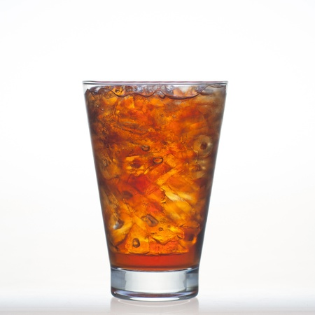 root beer: Root beer flavor aerated drinks whit water soda and ice in glass isolated on white Stock Photo
