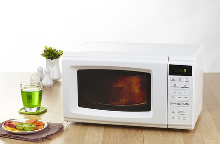 oven: Microwave the kitchenware home appliance isolated in the kitchen interior