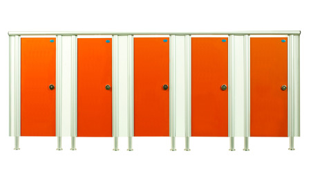 Colorful orange restroom stall doors isolated on white background  photo