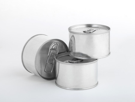 Milk tin cans isolated on white background  photo
