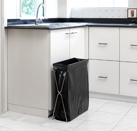 bin: Garbage bag with holder in the kitchen interior  Stock Photo