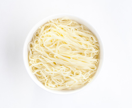 instant noodle: Egg noodle in a white bowl isolated on white background Stock Photo