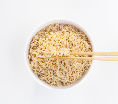 non  toxic: Instant noodle in a bowl with chopsticks isolated on white background