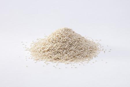 white sesame seeds: Heap of white sesame seeds isolated on white
