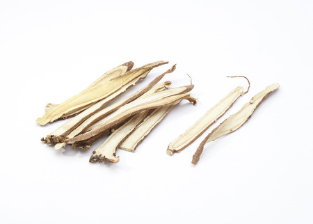 licorice: Slice liquorice roots the seasoning for cooking isolated on white background