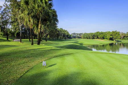 field of thai: Beautiful green golf course in a sunny day, Thailand Stock Photo