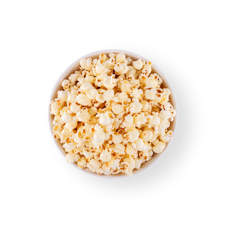 bowl of popcorn: Top view popcorn in white bowl isolated on white background