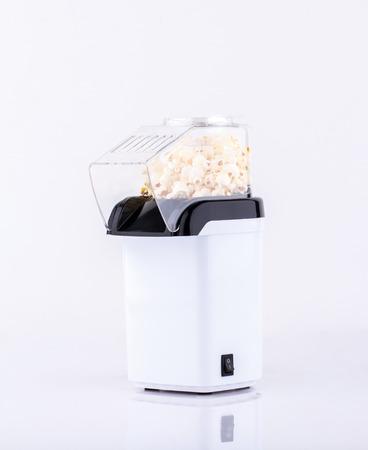 bowl of popcorn: Popcorn making machine isolated on white