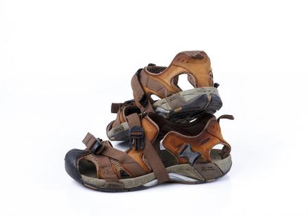 sandal: Sandalia viejo aislado en el fondo blanco Foto de archivo