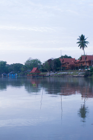 early morning: The Thai middle region style house along the river in early morning, Uthaithani Thailand