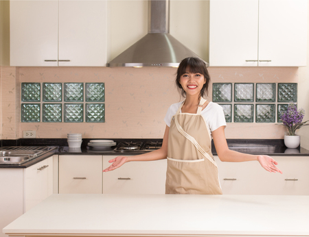 Beautiful Thai girl with modern style kitchen background