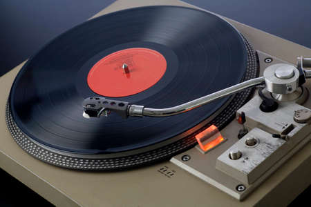 Retro record player spinning with needle approaching the record   Stock fotó
