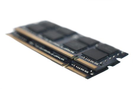 A section of the golden connectors on the ends of two sticks of lap top RAM isolated on white