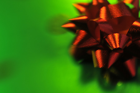 A red bow on green wrapping paper