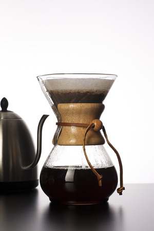 Freshly brewed pour over coffee with a kettle  Stock fotó