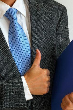 Gentleman with his thumb up signaling success Imagens