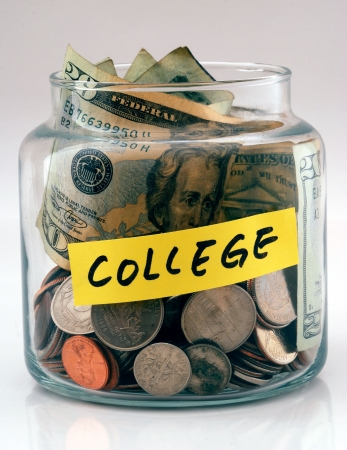 """college fund savings: A lot of money in a glass bottle labeled """"College"""""""