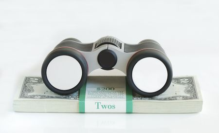 A binocular on the top of a stack of $2 dollar bills: Your Text is on the Lens