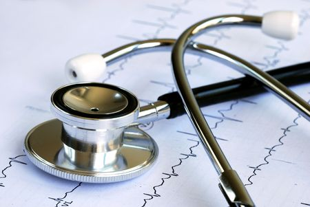 A stethoscope on the top of the EKG chart Stock Photo
