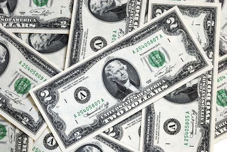 A spread of United States $2 dollar bills Stock Photo - 6752119