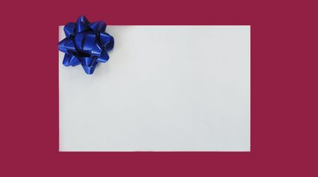 celebration background: Illustration of blue Christmas bow on the white card isolated on purple background Stock Photo