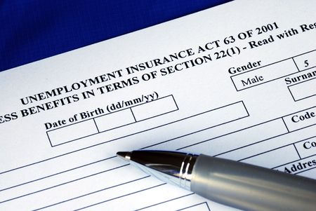 Filling the unemployment insurance application form isolated in blue  Stock Photo