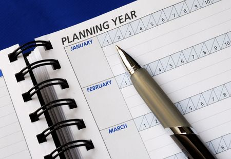 Planning the year on the day planner Stock Photo