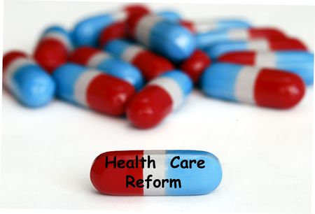 Health Care Reform pills isolated on white photo