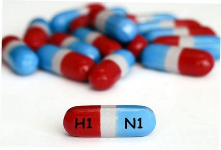 H1N1swine flu pills isolated on white photo