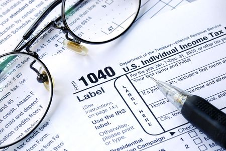 Working on the United States Income Tax 1040 Stock Photo - 6752780