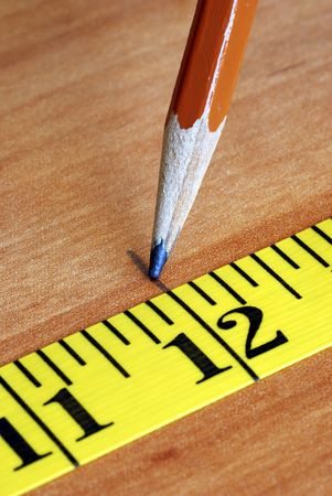 Measuring tape and pencil are tools for carpenters  photo